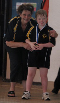 Sammy proudly displaying his medal with our Director of Swimming
