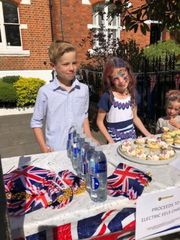 James and Isobel spent the day of the Royal Wedding selling cakes, water and flags to the public outside their home in Windsor.